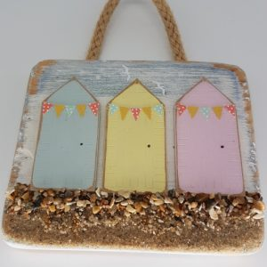 Driftwood Decoration featuring beach huts