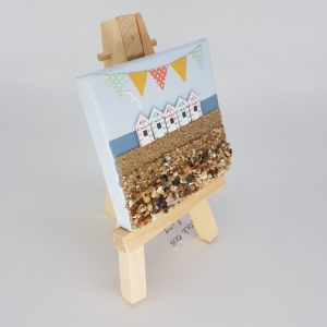 wooden beach huts on easel