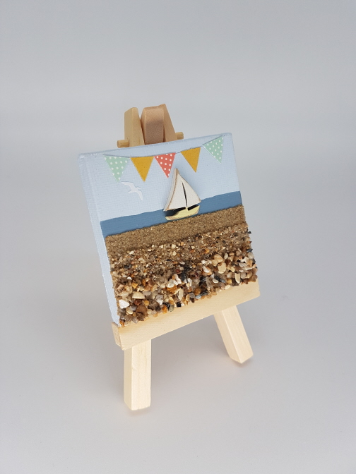 Wooden boat on a mini easel
