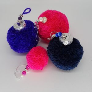 pink and purple pom pom set